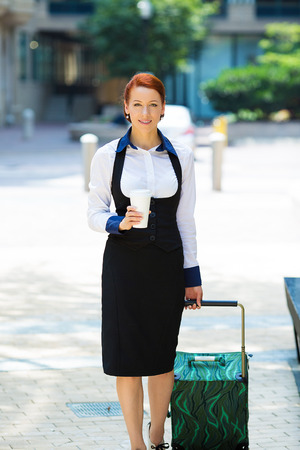 heals: Business woman going on trip.