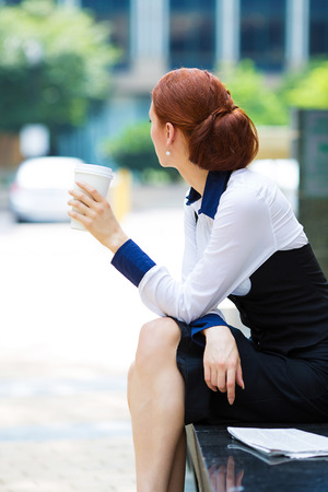 Portrait, picture back side view, sad depressed, lonely business woman photo