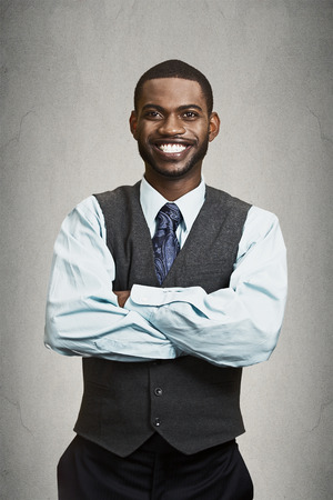 american banker: Closeup portrait handsome happy, young, smiling business man with arms crossed, confident student agent, entrepreneur isolated black grey background. Positive face expression emotion feeling, attitude