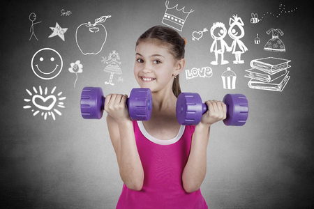 retouch: Happy little girl lifting dumbbells, smiling cheerful, fresh, energetic, isolated black background with graphics. Summer time, vacation, active life style concept. Positive emotions, face expression Stock Photo