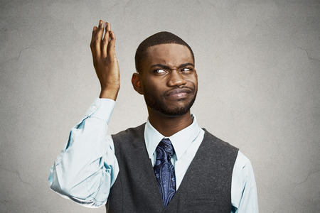 ambiguous: Closeup portrait, headshot dumb clueless young man, arms out asking whats problem who cares so what, I dont know.  Stock Photo