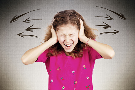 meltdown: Closeup portrait angry upset, stressed little young girl, having nervous breakdown, screaming isolated black background. Negative human emotion facial expression, feeling attitude, reaction perception Stock Photo