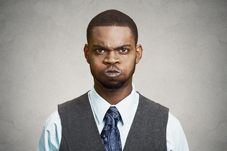strong boy: Closeup portrait angry young business man, blowing steam, about to have nervous atomic breakdown, isolated black background. Negative human emotions, facial expressions, reaction, feelings attitude Stock Photo