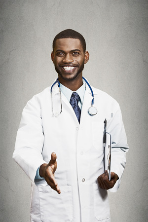 medical practitioner: Closeup portrait smiling healthcare professional, male doctor with stethoscope, holding clipboard giving handshake isolated black background. Patient visit, health care plan. Cardiology appointment
