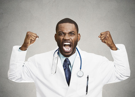 angry person: Closeup portrait rude frustrated upset overwhelmed, angry doctor, mad health care professional, screaming at nurse, patient, fists up in air isolated black background. Human face expressions, emotions