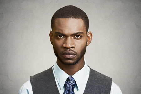 ego: Closeup portrait, headshot handsome serious corporate business man looking at you gesture skeptically, isolated black background. Negative human emotions, facial expression, feeling, body language