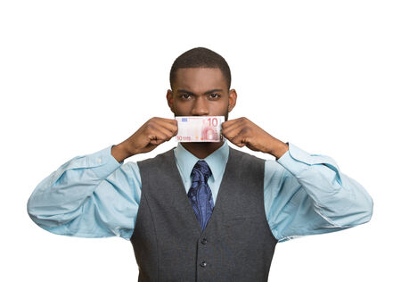 sweeten: Closeup portrait handsome young corrupt corporate man in blue shirt holding euro bill currency to his mouth, isolated white background. Bribery concept in politics business, diplomacy. Life perception Stock Photo