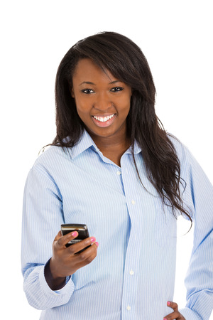 american content: Closeup portrait, happy, smiling girl, looking at you, holding cell, smart phone, isolated white background. Positive facial expression, reaction. Business woman sending text message from her mobile.