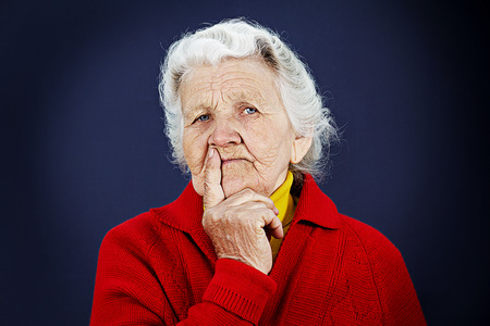 distrust: Closeup portrait, senior, serious mature, older woman, looking at you camera gesture skeptically isolated black background. Negative human emotion facial expression, feeling, body language, perception Stock Photo