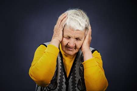 heartbroken: Closeup portrait, headshot sad alone dark gloomy frustrated, stressed senior mature woman having bad headache, nightmare day isolated black background. Negative human emotion facial expression feeling