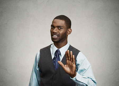 Closeup portrait furious angry annoyed displeased young man raising hands up to say no stop right there isolated grey background. Negative human emotion facial expression sign symbol body language photo
