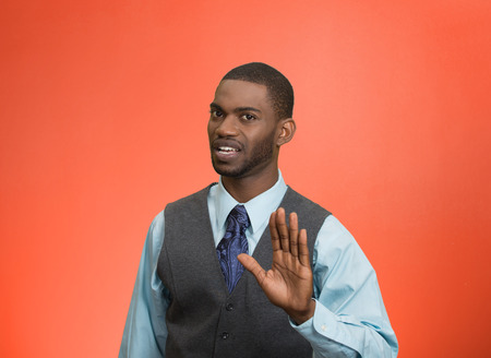 Closeup portrait furious angry annoyed displeased young man raising hands up to say no stop right there isolated red background. Negative human emotion facial expression sign symbol body language
