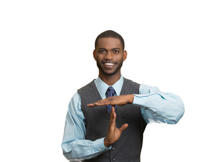Closeup portrait young, happy, smiling, executive company man showing time out gesture with hands, isolated white background. Positive human emotions, facial expression feeling, body language attitude photo