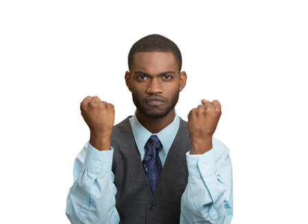 aggravated: Closeup portrait angry cranky, upset, pissed off young man, worker, business employee putting up fist ready to give knuckle sandwich isolated white background. Negative emotion facial expression feeling Stock Photo