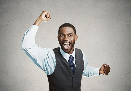 enrolled: Closeup portrait excited, energetic, happy, screaming student, business man winning, arms, fists, hands pumped, celebrating success isolated grey background. Positive human emotion facial expression