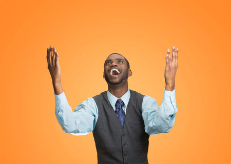 enrolled: Closeup portrait excited, energetic, happy, screaming student, business man winning, arms, fists hands pumped, celebrating success isolated orange background. Positive human emotion, facial expression
