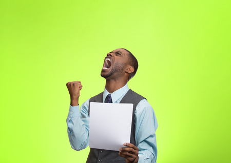 refinance: Closeup portrait angry, mad, screaming business man holding paper, document, screaming, looking up isolated green background. Negative emotions, facial expressions, feeling. Financial crisis, bad news