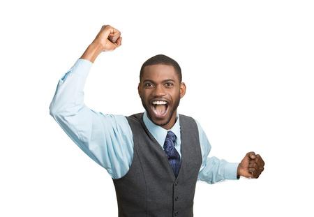 lenguaje corporal: Retrato del primer excitado, enérgico, feliz, estudiante gritando, hombre de negocios ganador, brazos, puños, manos bombeados, celebrando el éxito aislado fondo blanco. La expresión facial positiva las emociones humanas Foto de archivo