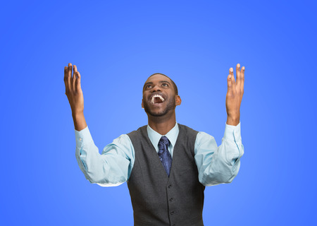 enrolled: Closeup portrait excited, energetic, happy, screaming student, business man winning, arms, fists hands pumped, celebrating success isolated blue background. Positive human emotion, facial expression Stock Photo