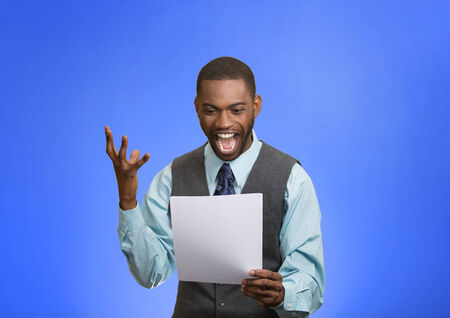 decreased: Closeup portrait happy excited young business man executive looking monthly statement glad to pay off bills isolated blue background. Positive emotion facial expression. Financial success good news