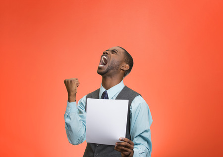 bank records: Closeup portrait angry, mad, screaming business man holding paper, document, screaming, looking up isolated red background. Negative emotions, facial expression, feeling. Financial crisis, bad news Stock Photo