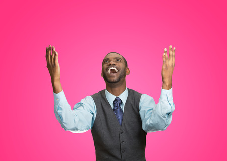 enrolled: Closeup portrait excited, energetic, happy, screaming student, business man winning, arms, fists hands pumped, celebrating success isolated pink background. Positive human emotion, facial expression Stock Photo