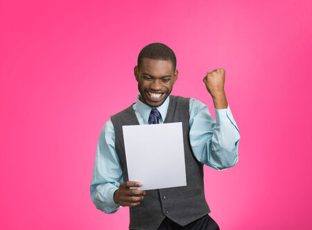 refinance: Closeup portrait happy excited young business man executive looking monthly statement glad to pay off bills isolated pink background. Positive emotion facial expression. Financial success good news Stock Photo