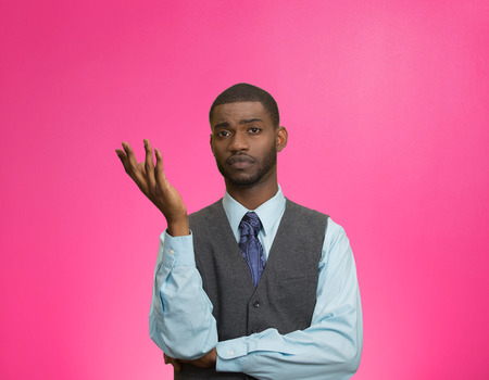 insensitive: Closeup portrait dumb clueless young executive man, arm out asking why what problem so who cares, I dont know, isolated pink color background. Negative human emotion facial expression feelings Stock Photo
