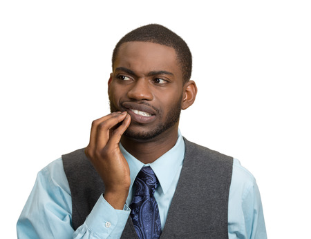 Closeup portrait handsome sad young executive man, student, worker touching face having bad pain, tooth ache, isolated white background. Negative human emotions, facial expressions, feeling reaction photo