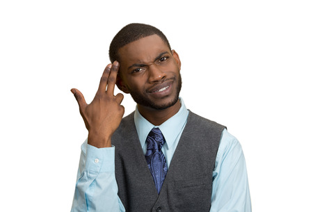 Closeup portrait rude, difficult, angry young executive businessman gesturing with fingers against temple, are you crazy? Isolated white background. Negative human emotion, facial expression, feelings