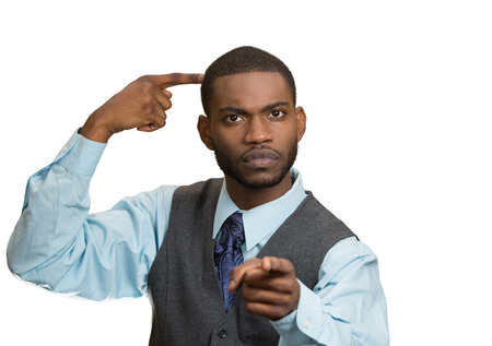 bonkers: Closeup portrait rude, difficult, angry young executive businessman gesturing with fingers against temple, are you crazy? Isolated white background. Negative human emotion, facial expression, feelings