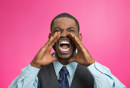 aggravated: Closeup portrait bitter mad, displeased pissed off, angry grumpy corporate man, open mouth, hands in air, screaming, yelling isolated pink background. Negative human emotion facial expression feeling Stock Photo