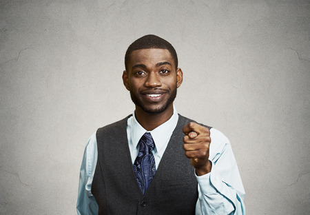 Closeup portrait smiling Business Man giving thumb, finger figa gesture you are going to get zero nothing isolated grey background. Negative emotions, facial expressions, feeling, body language, signs photo