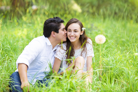 inseparable: Horizontal Portrait happy, smiling young couple, man and woman, relaxing, enjoying summer sunny day in park. Positive human face expressions, emotions, feelings, life perception. Relationship concept