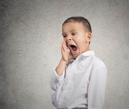 deprivation: Closeup portrait tired child yawning, funny looking boy isolated grey wall background  Human facial expression, emotion, feeling, body language  Long school hours, busy day concept, lack of motivation Stock Photo