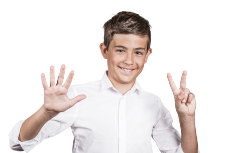 non verbal: Closeup portrait excited, successful young man giving number 7 hand gesture, showing seven fingers isolated white background. Positive emotion face expression, signs, reaction non verbal body language