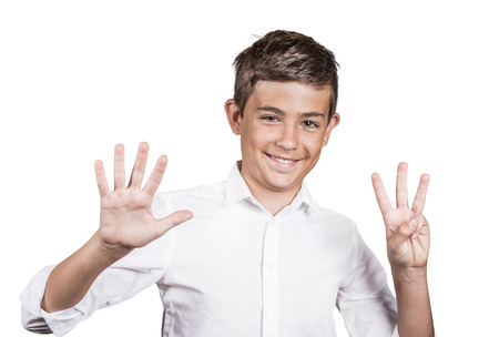 non verbal: Closeup portrait excited, happy, successful young man showing eight fingers, giving number 8 sign, isolated on white background. Positive emotion face expression, non verbal communication body language Stock Photo