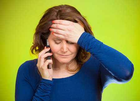 worry: Young sad woman talking on mobile phone upset, depressed, unhappy, worried, isolated green background. Negative human emotions, facial expressions, feelings, life perception, reaction. Bad news