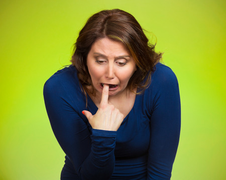 fed up: Closeup portrait young woman, annoyed, frustrated fed up sticking fingers in her throat showing she is about to throw up. Case anorexia nervosa, Isolated green background. Negative face expression Stock Photo