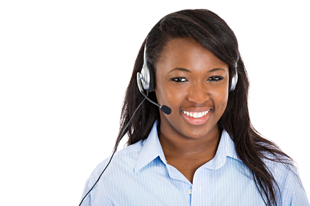 Closeup portrait smiling adorable female customer representative business woman with phone headset chatting on line with customer isolated white background. Positive human emotions, facial expressions Stock Photo
