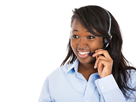Closeup portrait smiling adorable female customer representative business woman with phone headset chatting on line with customer isolated white background. Positive human emotions, facial expressions Banque d'images