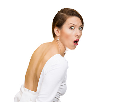 startled: Closeup portrait, young, scared, afraid, woman, citizen, employee, full of fear on run, chased by someone, isolated white background. Human face expressions, emotions, reaction, feelings, attitude Stock Photo