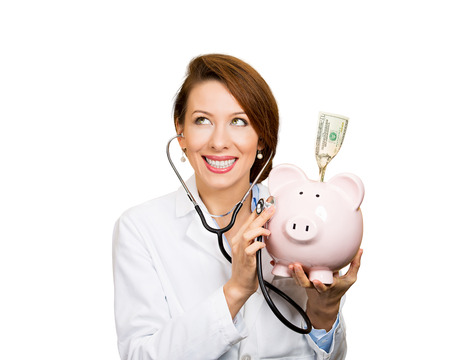 reimbursement: Closeup portrait, health care professional, doctor, nurse listening with stethoscope to piggy bank, dollar bill, isolated white background. Medical insurance, medicare reimbursement, reform concept