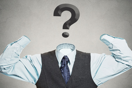 questionmark: Desperate businessman with question mark instead of head has no hands tools to solve multiple financial issues isolated grey wall background. Corporate problems lack of solutions concept. Hopelessness Stock Photo