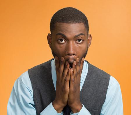 devastated: Closeup portrait, headshot of young man tired isolated on orange background Stock Photo