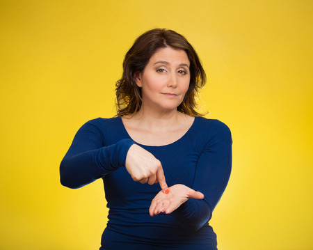 ex wife: Upset woman gesturing pay me my money back, finger on palm gesture, isolated yellow background. Human face expressions, emotion feelings body language, non verbal communication. Financial debt concept