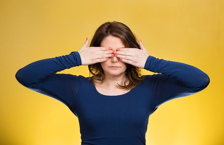 withhold: Closeup portrait young middle aged woman, closing, covering eyes with hands can