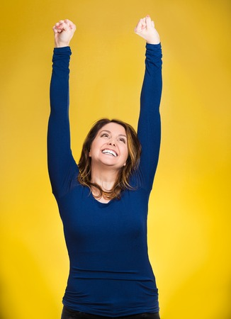 jubilate: Closeup portrait winning successful young business woman happy ecstatic celebrating being winner isolated yellow background. Positive human emotion facial expression, attitude Life achievement concept
