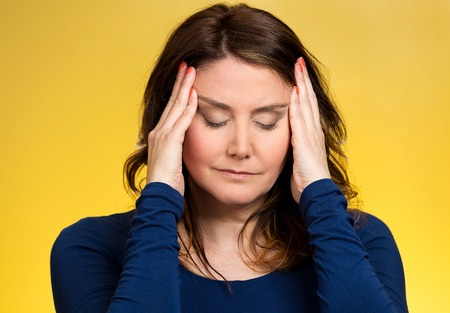 Closeup portrait middle aged stressed woman having so many thoughts, worried about future, thinking, isolated yellow background. Human facial expressions, feelings, emotions, attitude, life perception