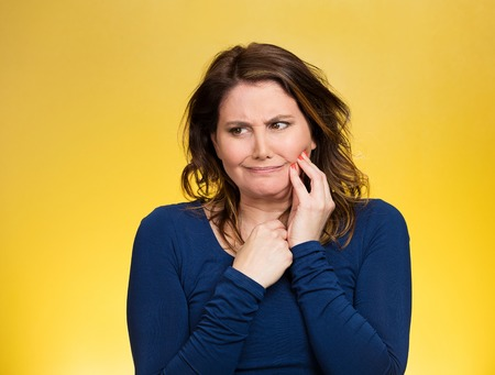 abscess: Portrait middle aged woman with sensitive tooth ache, crown problem crying from pain, touching outside mouth with hand isolated yellow background. Negative emotion, facial expression feeling, health Stock Photo